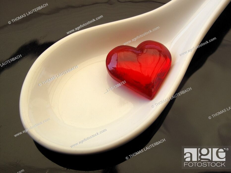Stock Photo: Small glass heart is in medicine spoon.