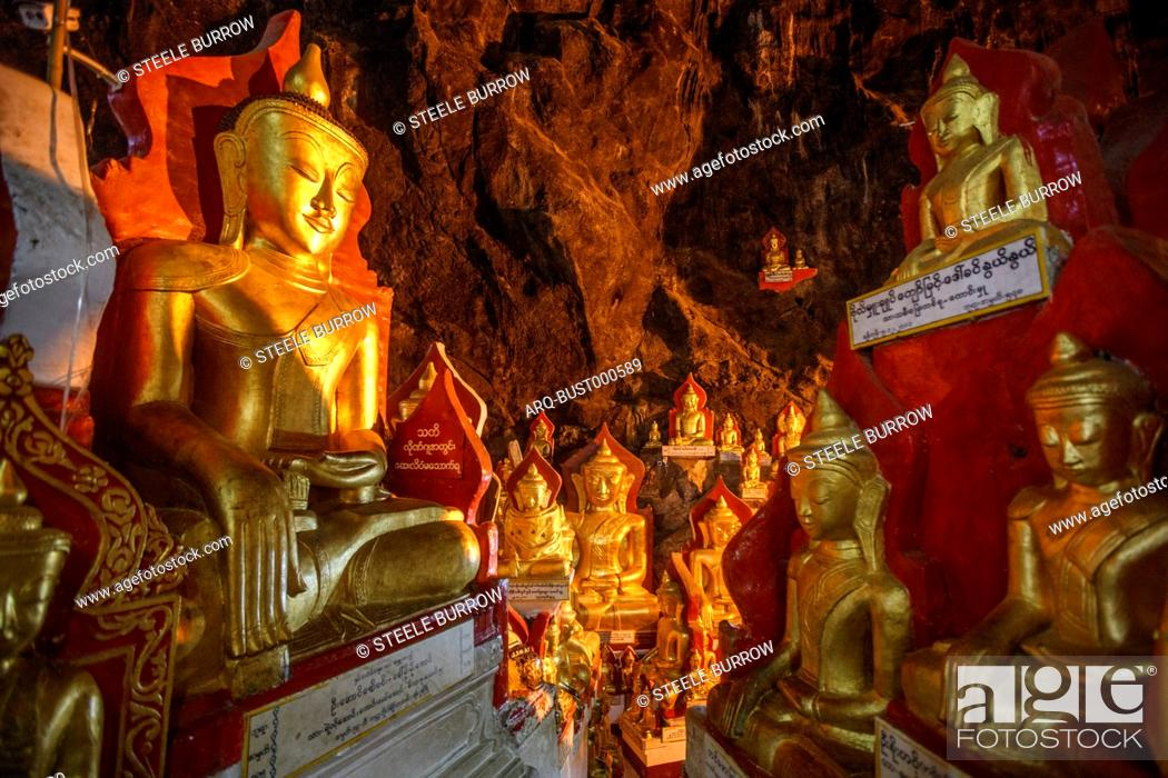 Imagen: Gold Buddha statues line the sides of the famous Pindaya Caves in Shan State, Myanmar. The cave is a common tourist destination and pilgrimage site for.