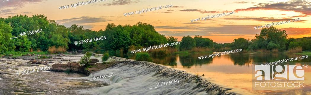 Stock Photo: Beautiful view of the dam on the Southern Bug River at sunset. Village of Migiya, Ukraine, on a sunny summer evening.
