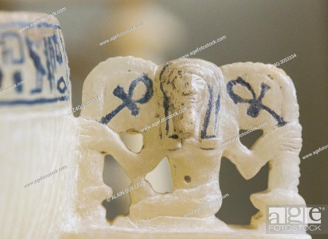 Stock Photo: Egypt, Cairo, Egyptian Museum, Tutankhamon alabaster, from his tomb in Luxor, detail of a cup : The god Heh holds stems meaning eternal life.