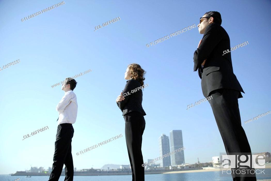 Stock Photo: Business team looking towards horizon.