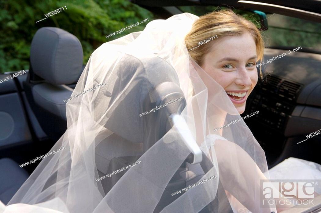 Stock Photo: Bride in a convertible.