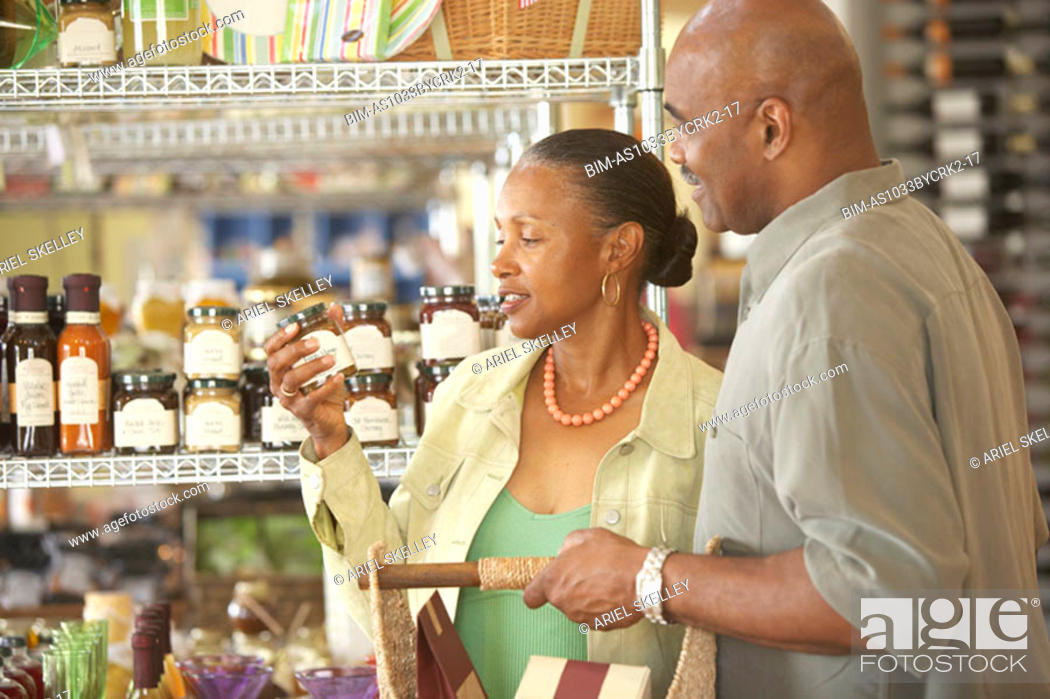 Stock Photo: African American couple grocery shopping.