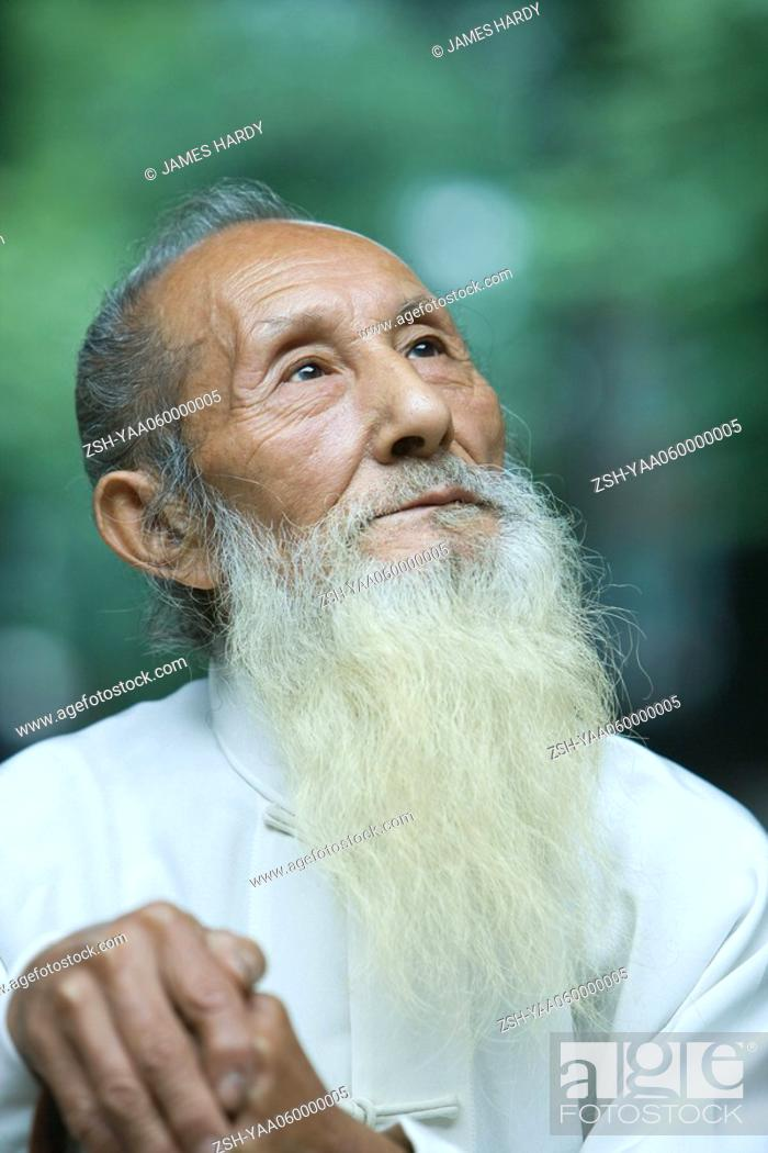 Stock Photo: Elderly man in traditional Chinese clothing, looking up, portrait.