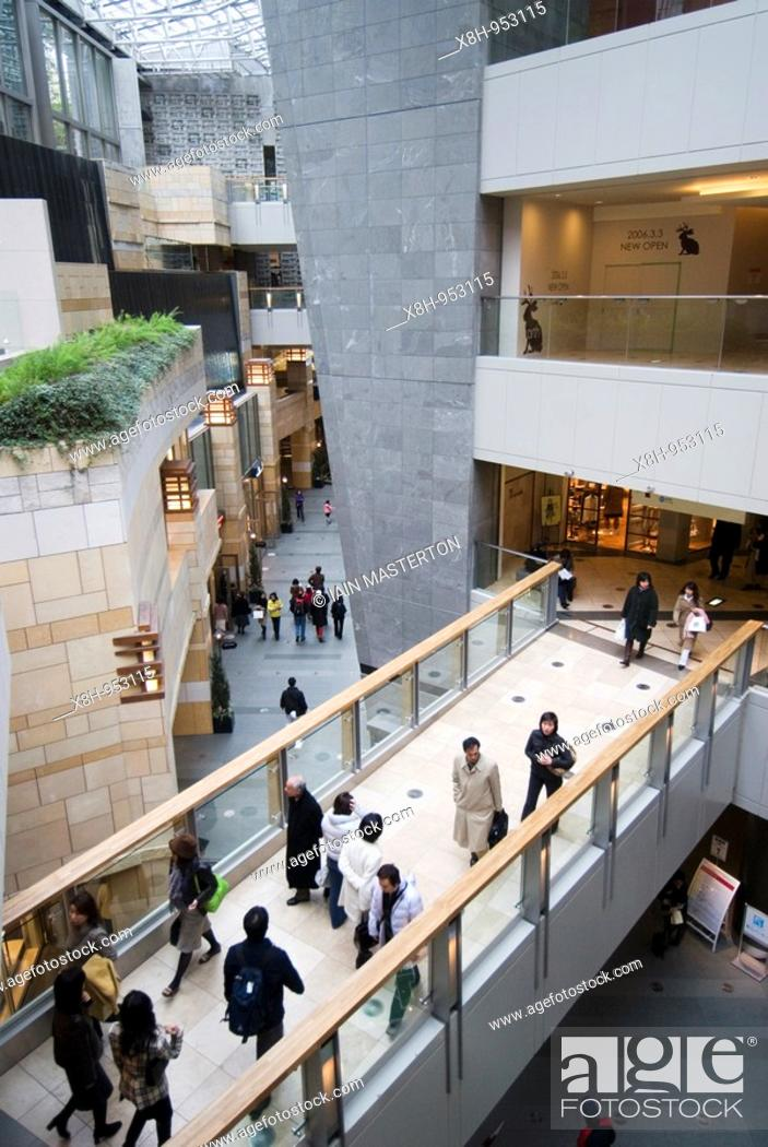 Stock Photo: Interior of modern upmarket shopping mall at Mori Building in Roppongi Tokyo Japan.