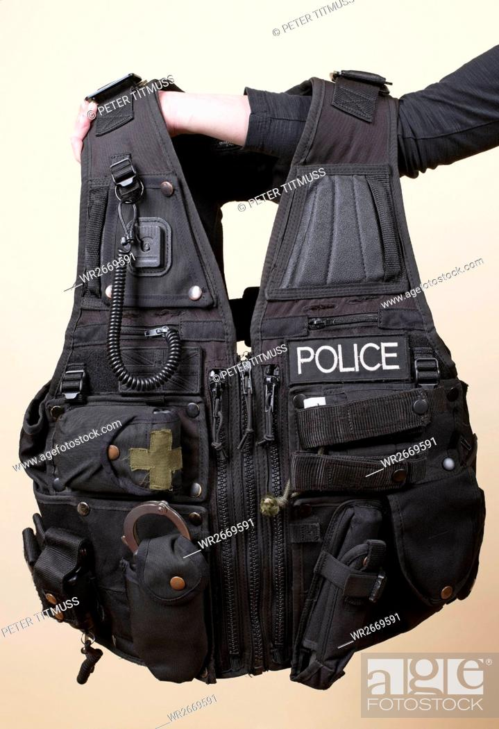Stock Photo: Person Holding Police Tactical Vest.