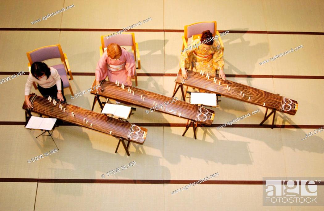 Stock Photo: Women playing koto (Japanese traditional musical instrument). Kyoto, Japan.