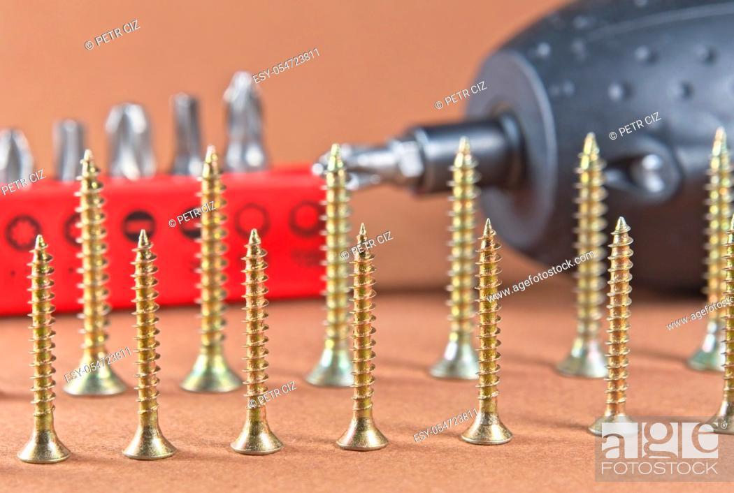 Stock Photo: Tools drill bits accessories. Wood screws, drill bits and cordless drill close-up.