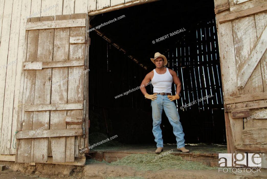 Stock Photo: Rancher standing at doorway of barn. Poway, California. USA.