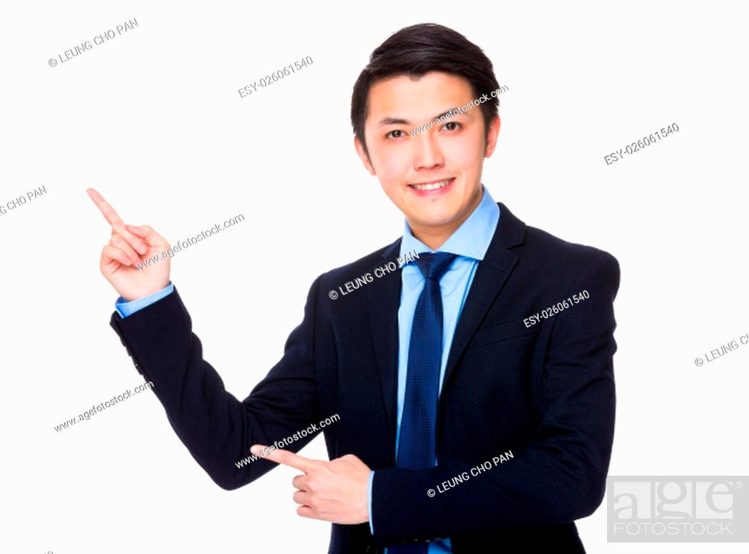 Stock Photo: Asian Young Businessman showing finger point up.