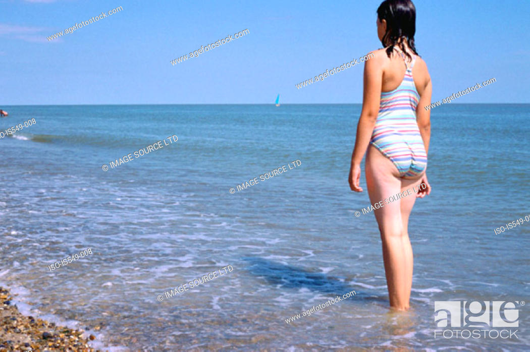 Stock Photo: Girl standing in the sea.