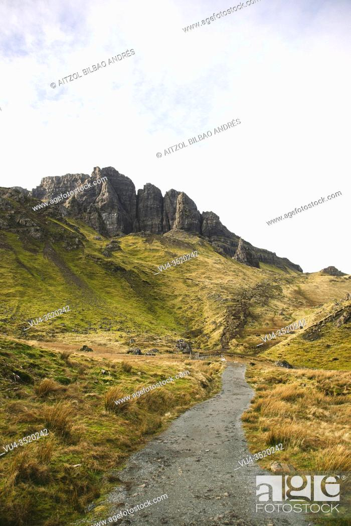 Stock Photo: The uphill trail to the Old Mann of Storr, the hill presents a steep rocky eastern face overlooking the Sound of Raasay, contrasting with gentler grassy slopes.