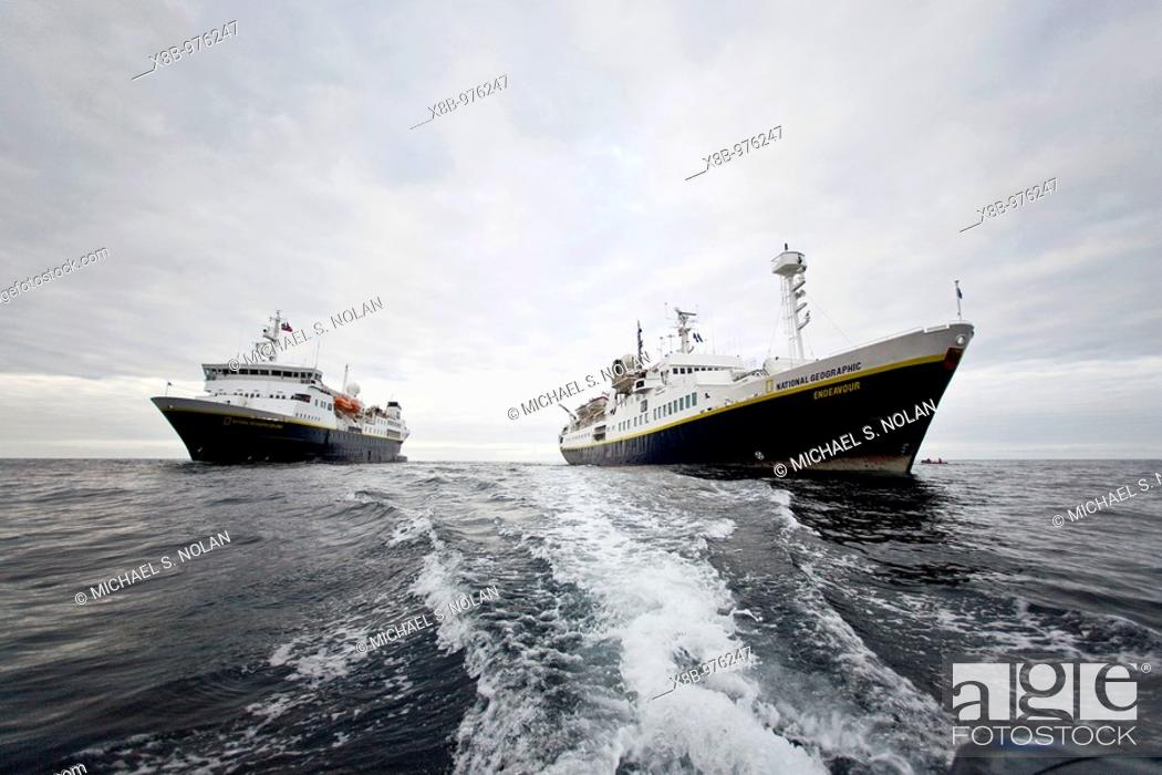 Stock Photo: The Lindblad Expedition ships National Geographic Explorer and National Geographic Endeavour operating in and around the Antarctic peninsula in Antarctica.