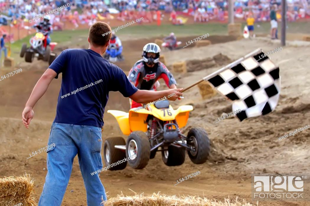 Stock Photo: Checkered flag signals the end of the race at an ATV All Terrain Vechiles off road motocross type of race.