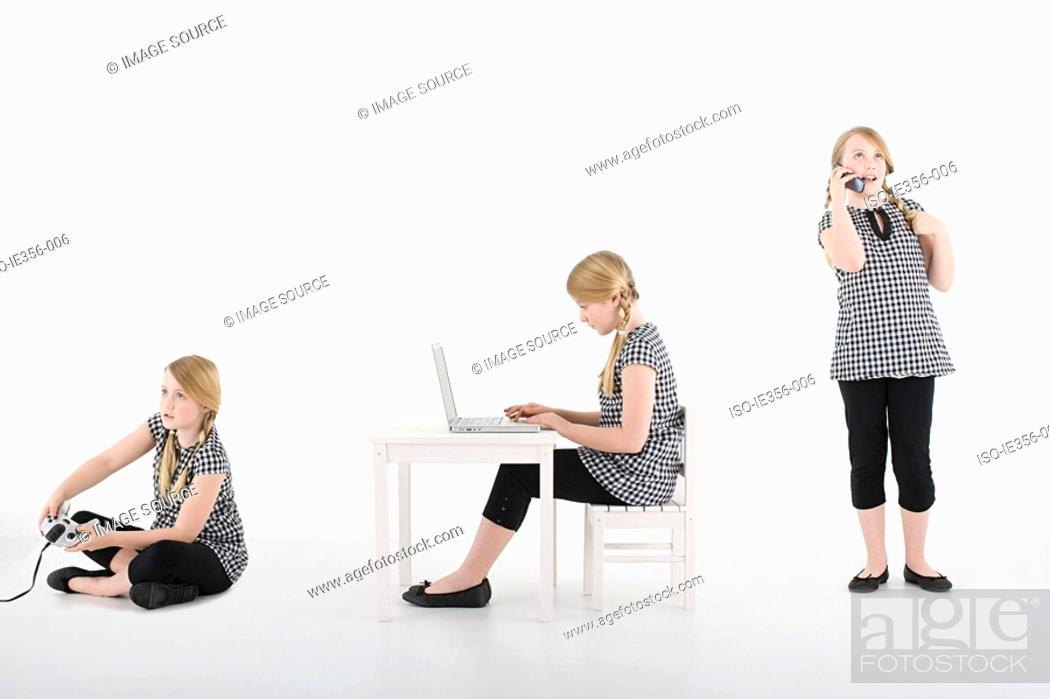 Stock Photo: Girl with gadgets.