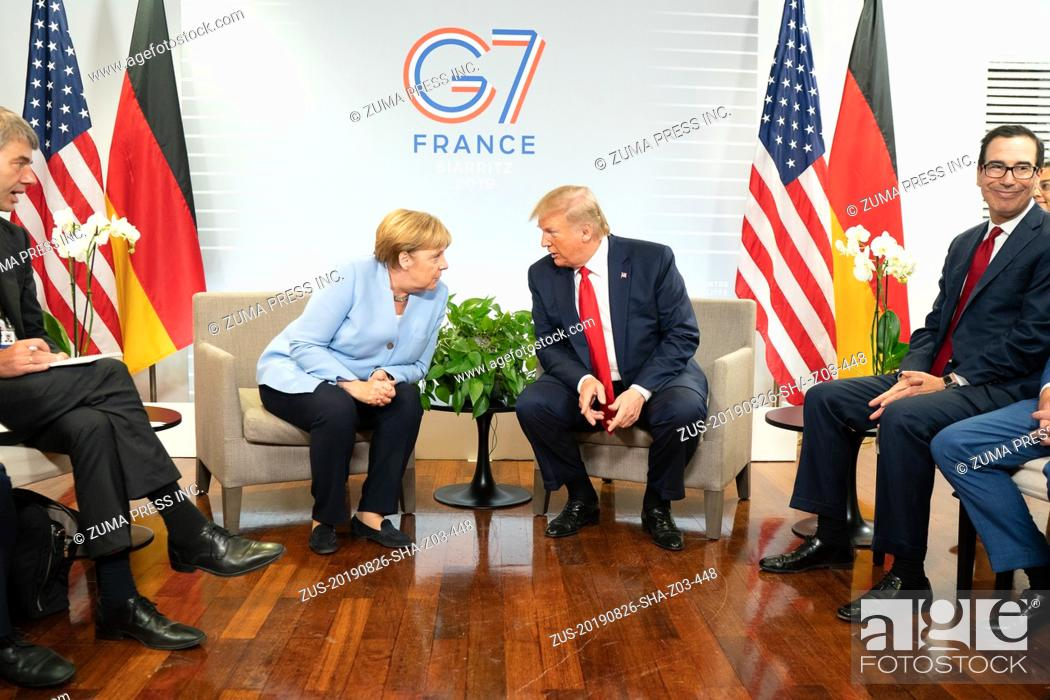 Stock Photo: August 26, 2019 - Biarritz, France - US President DONALD TRUMP and ANGELA MERKEL at the G7 Summit in Biarritz, France (Credit Image: © White House/ZUMA.