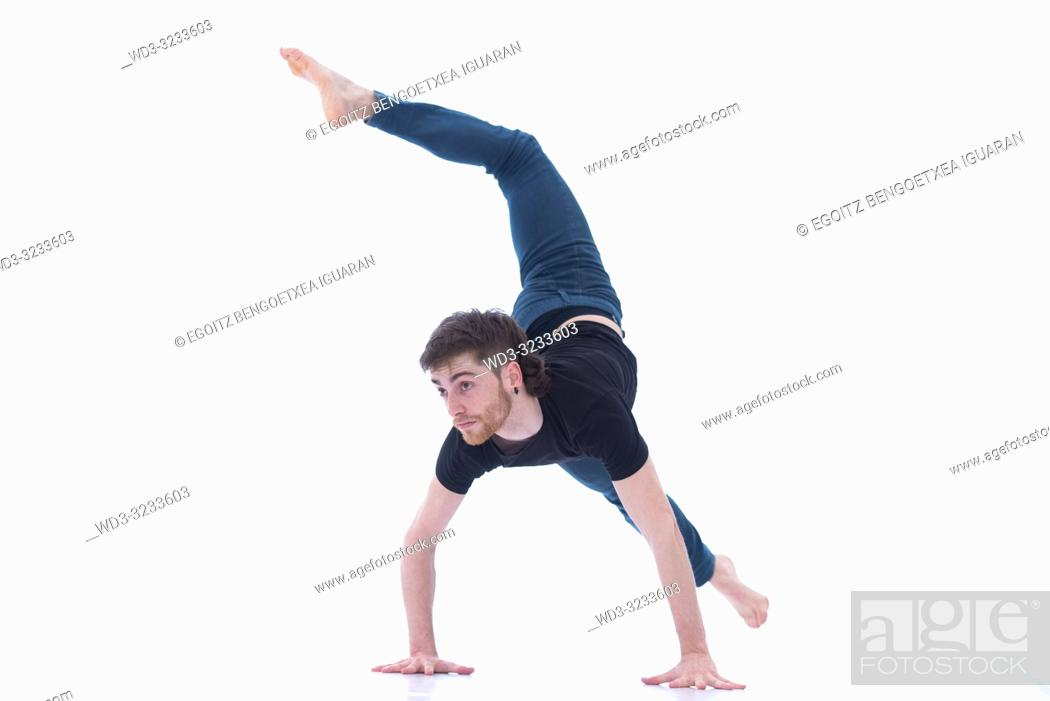 Stock Photo: Casual dressed contemporary dancer on white background.