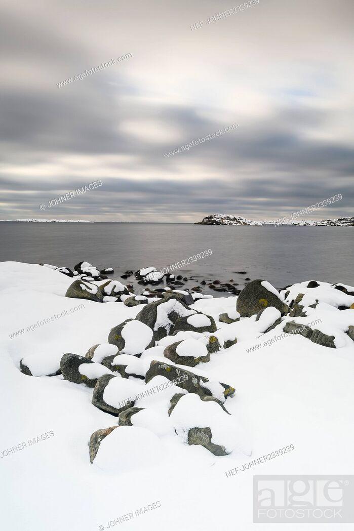 Stock Photo: Snow covering coast.