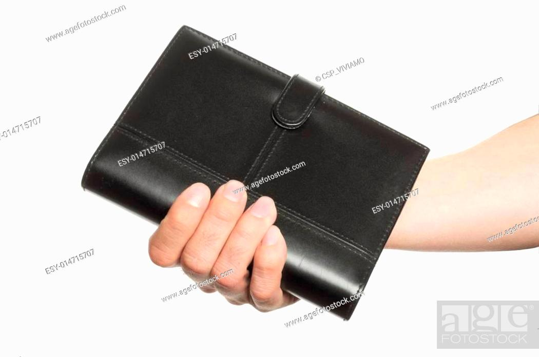 Stock Photo: hand hold business diary.
