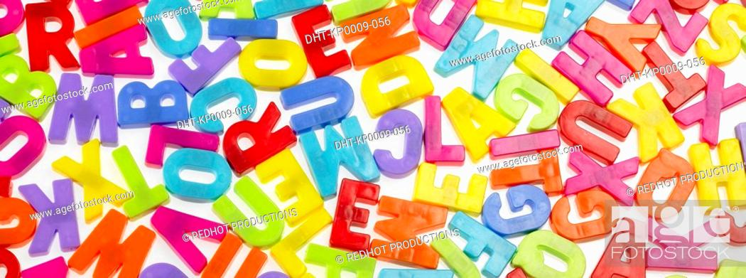 Stock Photo: Various coloured plastic Letter magnets.