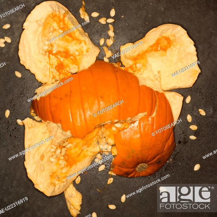 Stock Photo: Pumpkin smashed on concrete floor.