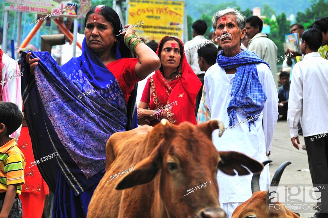 Stock Photo: Pilgrim couple at Lakshman Jhula in Rishikesh.