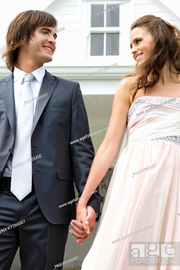 Stock Photo: Newlywed couple smiling at each other.