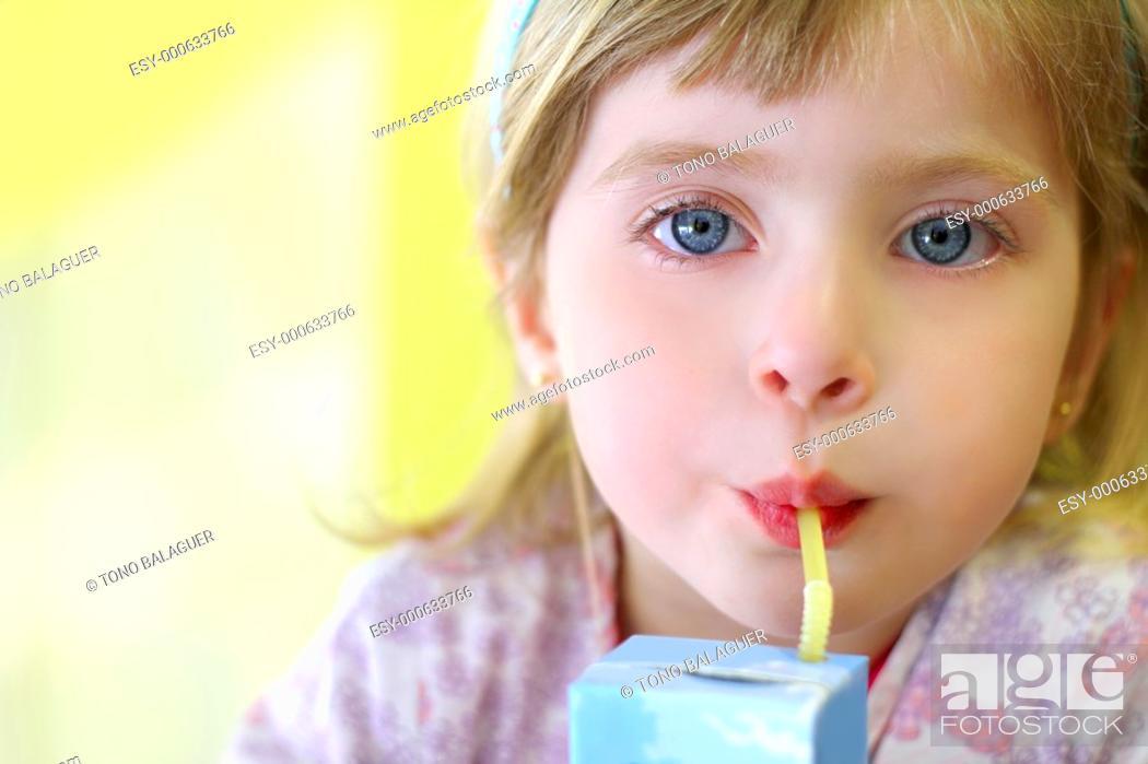 Photo de stock: blond little girl drinking straw tetra brick blue eyes.