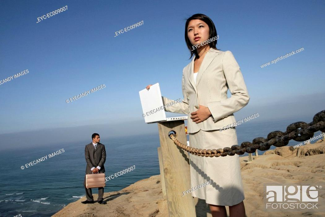 Stock Photo: View of two business professionals standing.