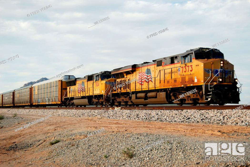 Stock Photo: Picacho, AZ, USA - October 18, 2014: An approaching diesel locomotive pulling boxcars.