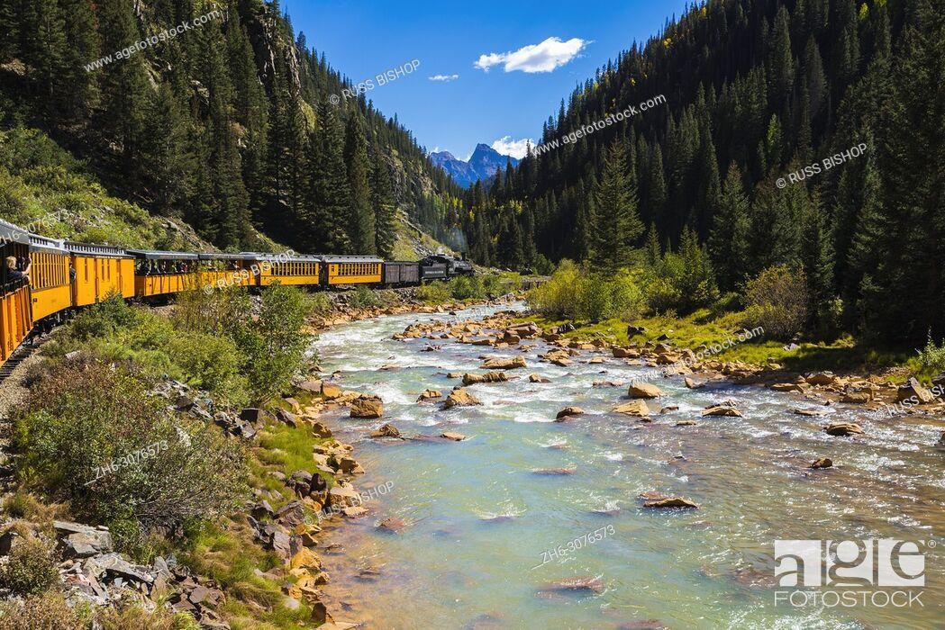Stock Photo: The Durango & Silverton Narrow Gauge Railroad on the Animas River, San Juan National Forest, Colorado USA.