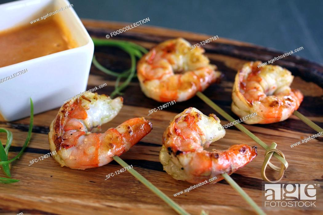 Stock Photo: Grilled shrimp with satay dipping sauce.