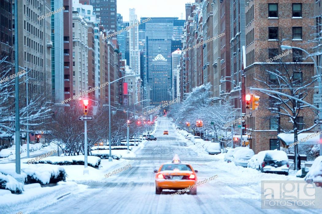 Stock Photo: Taxi on snowy city street.