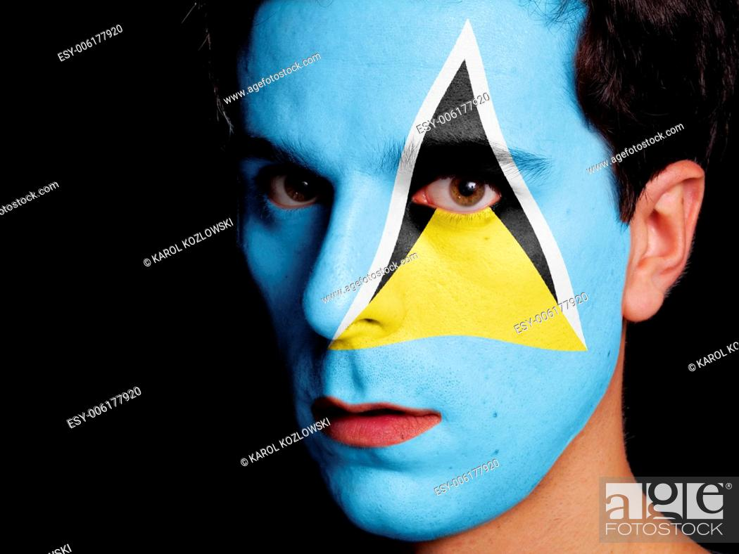 Stock Photo: Flag of Saint Lucia Painted on a Face of a Young Man.