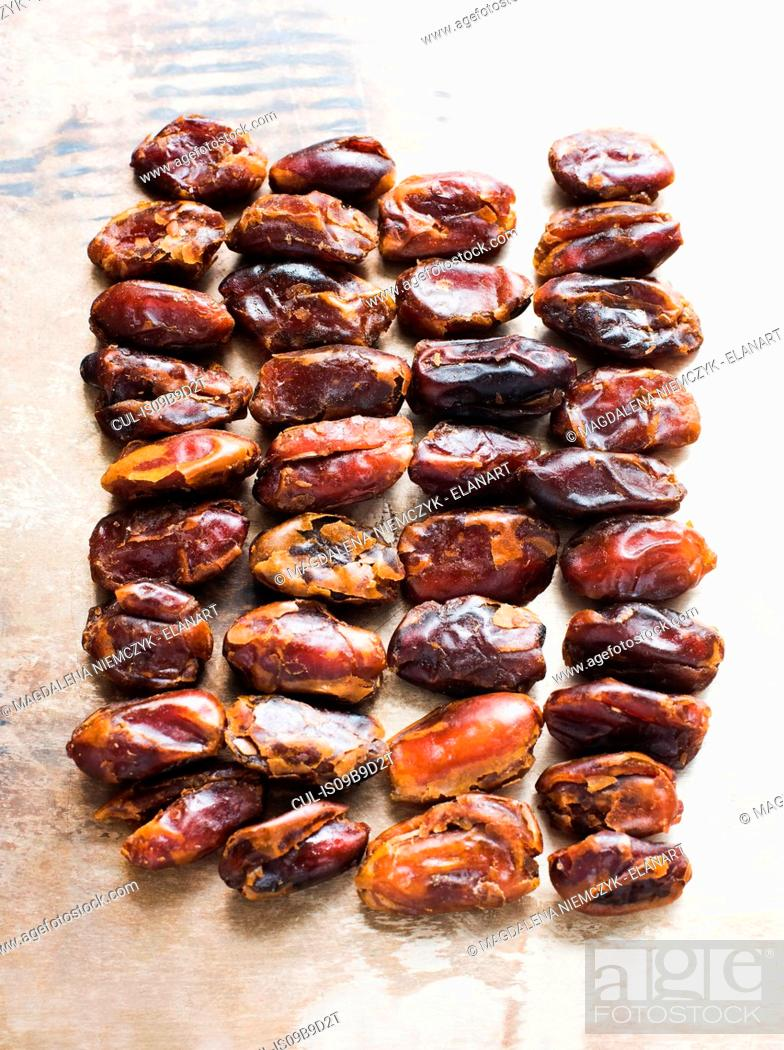 Stock Photo: Dried dates in rows, close-up.