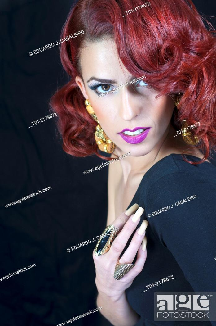 Stock Photo: red haired elegant fashion woman.