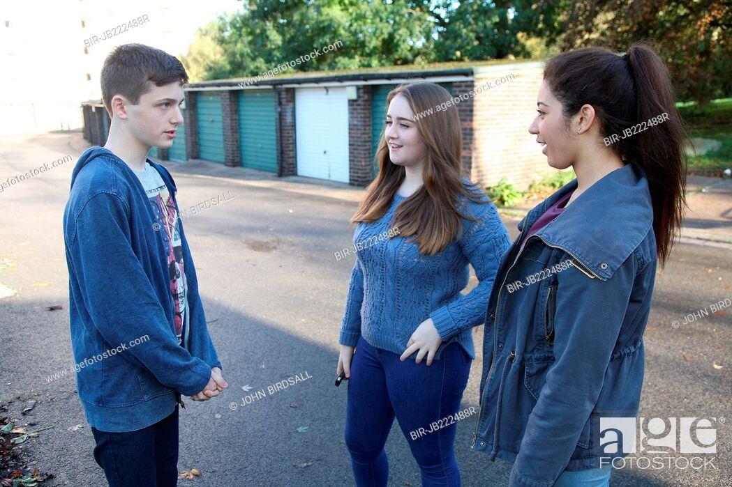 Stock Photo: Teenagers talking.