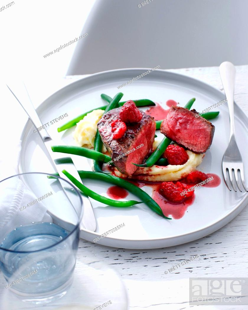 Stock Photo: Plate of filet with green beans.