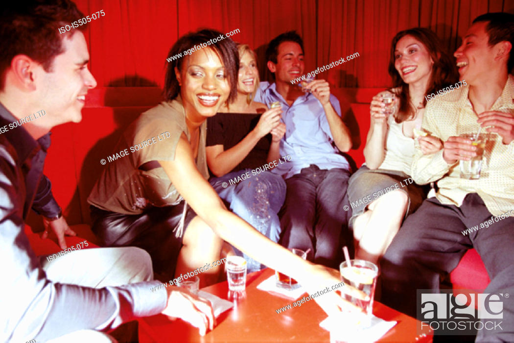 Stock Photo: Friends chatting in nightclub.