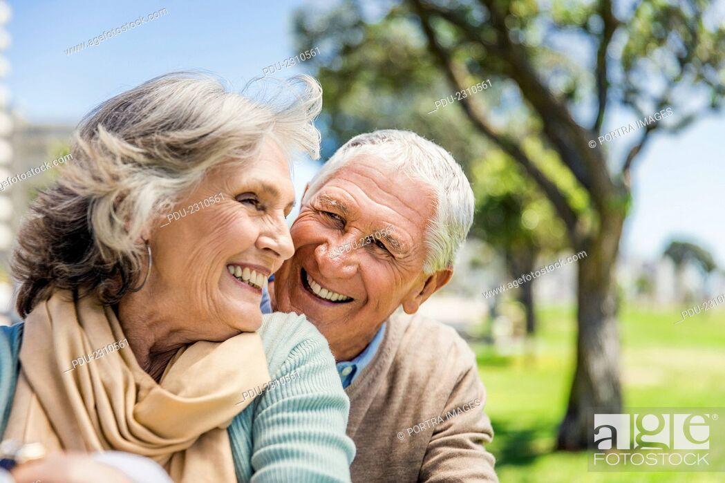 Stock Photo: Happy senior couple spending leisure time at park.