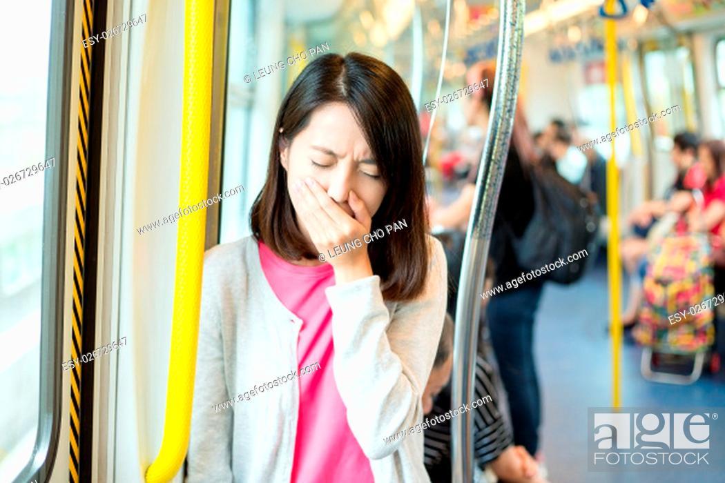 Stock Photo: Woman getting sick in train compartment.