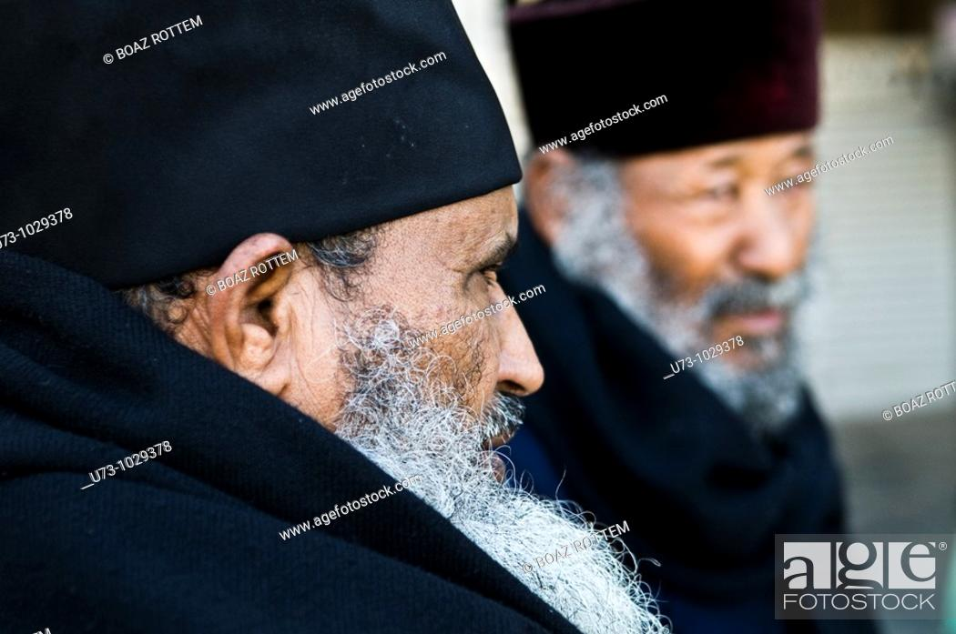 Stock Photo: Ethiopian Orthodox priests in the holy city of Jerusalem.