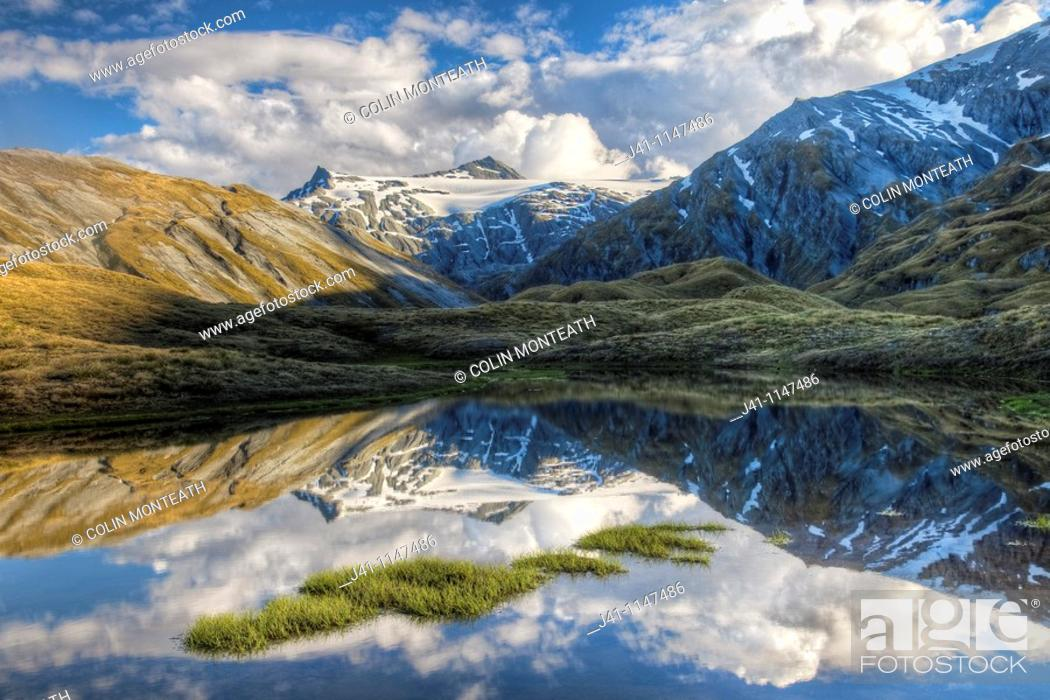 Stock Photo: Mt Tyndall, reflection in tarn, Cascade Saddle, Mount Aspiring National Park, Otago, New Zealand (January 2010).