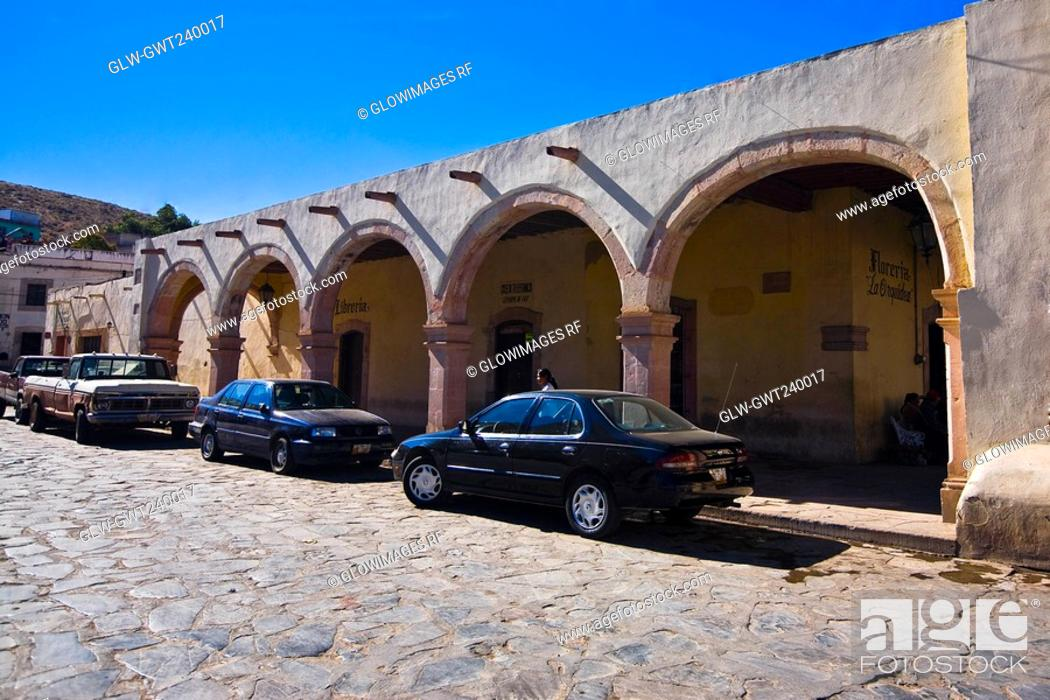 Stock Photo: Cars parked in front of a building, Sombrerete, Zacatecas State, Mexico.
