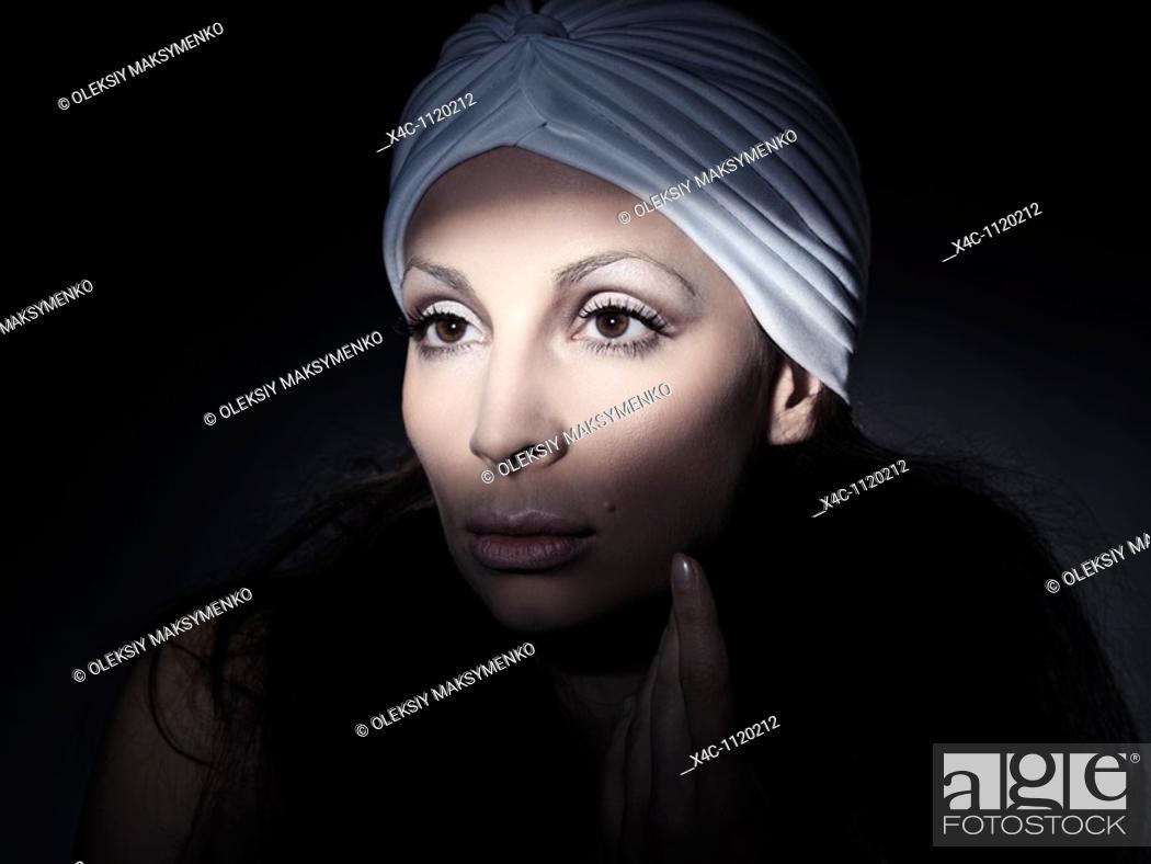 Stock Photo: Light falling on a beautiful woman face artistic portrait.