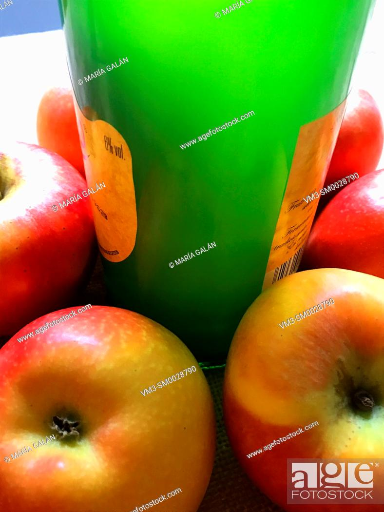 Stock Photo: Bottle of cider and apples. Asturias, Spain.