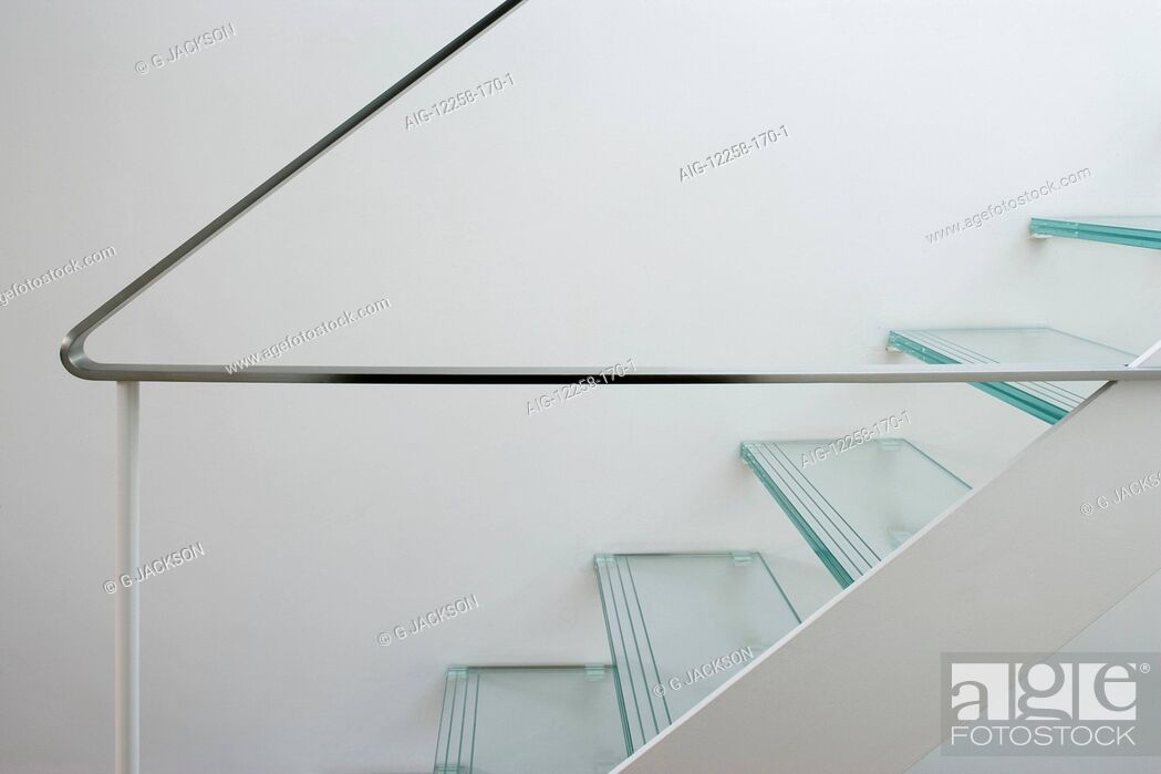 Stock Photo: Glass tread staircase and handrail in a Victorian house, Wandsworth, London.