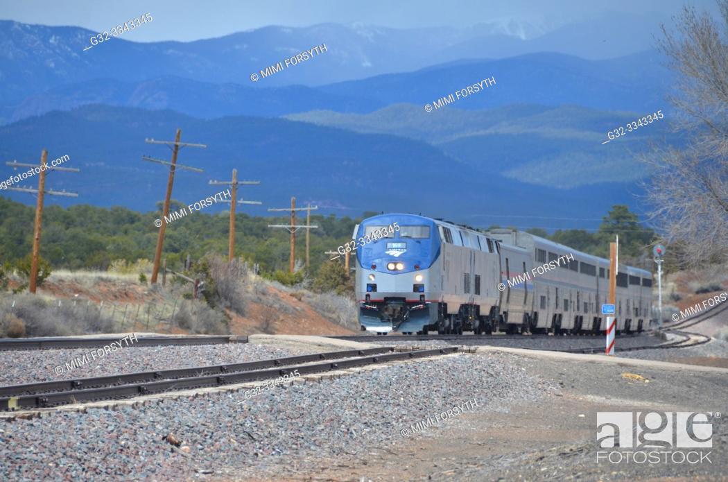 Stock Photo: passenger train passing through Rowe, New Mexico.