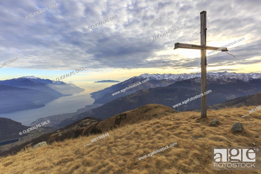 Stock Photo: The Bodone cross at sunset, in the background Como lake, Lombardy, Italy, provence of Como.