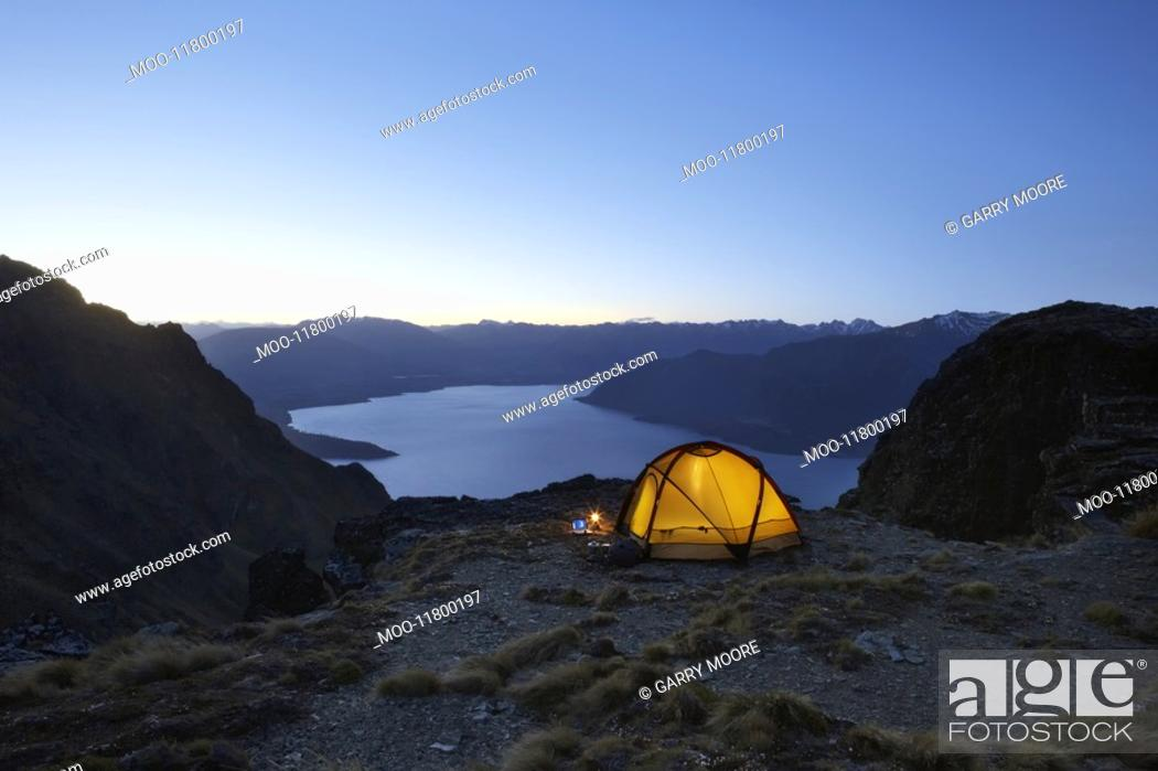 Stock Photo: Tent by lakeshore at dusk.